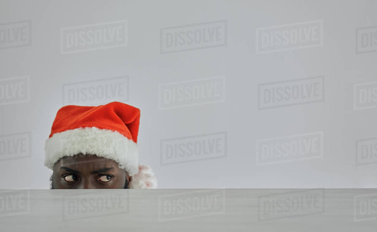 The african man in the red hat watching from the table Royalty-free stock photo