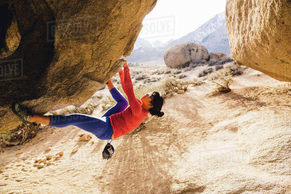 Woman rock climbing, Buttermilk Boulders, Bishop, California, USA Royalty-free stock photo