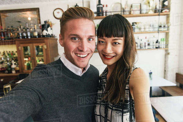Young couple taking selfie in cocktail bar Royalty-free stock photo