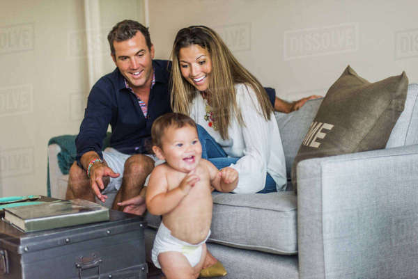 Couple smiling at happy son Royalty-free stock photo