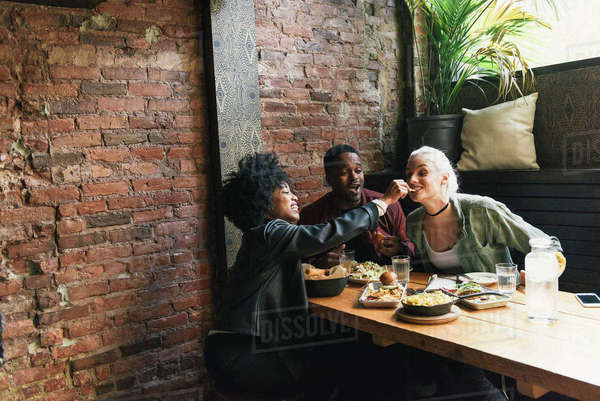 Friends sharing a meal together Royalty-free stock photo