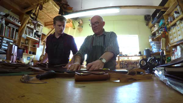 MS Craftsman teaching apprentice in leather workshop Royalty-free stock video