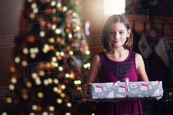Young girl holding christmas gift Royalty-free stock photo