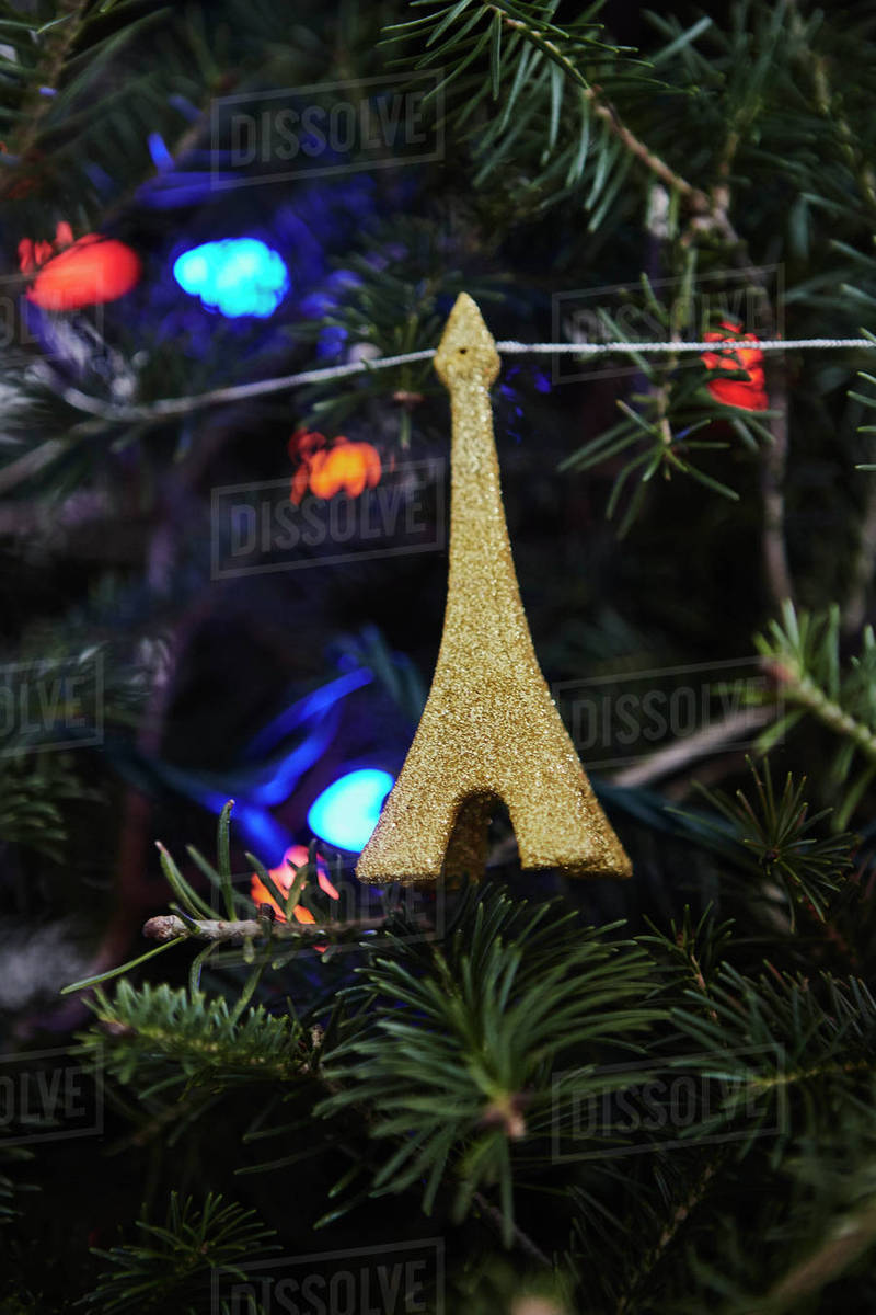 christmas decoration in the shape of the eiffel tower hanging on christmas tree close up