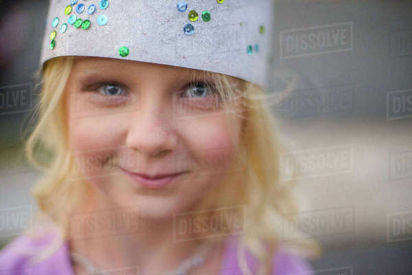 Girl in bejewelled paper crown Royalty-free stock photo