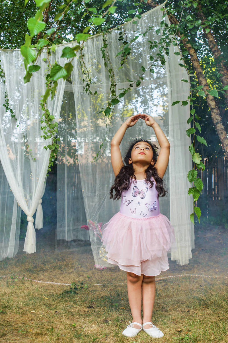 Portrait of young girl, dressed as fairy, dancing outdoors Royalty-free stock photo