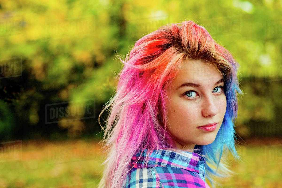 Portrait Of Teenage Girl With Multi Coloured Hair Outdoors Stock