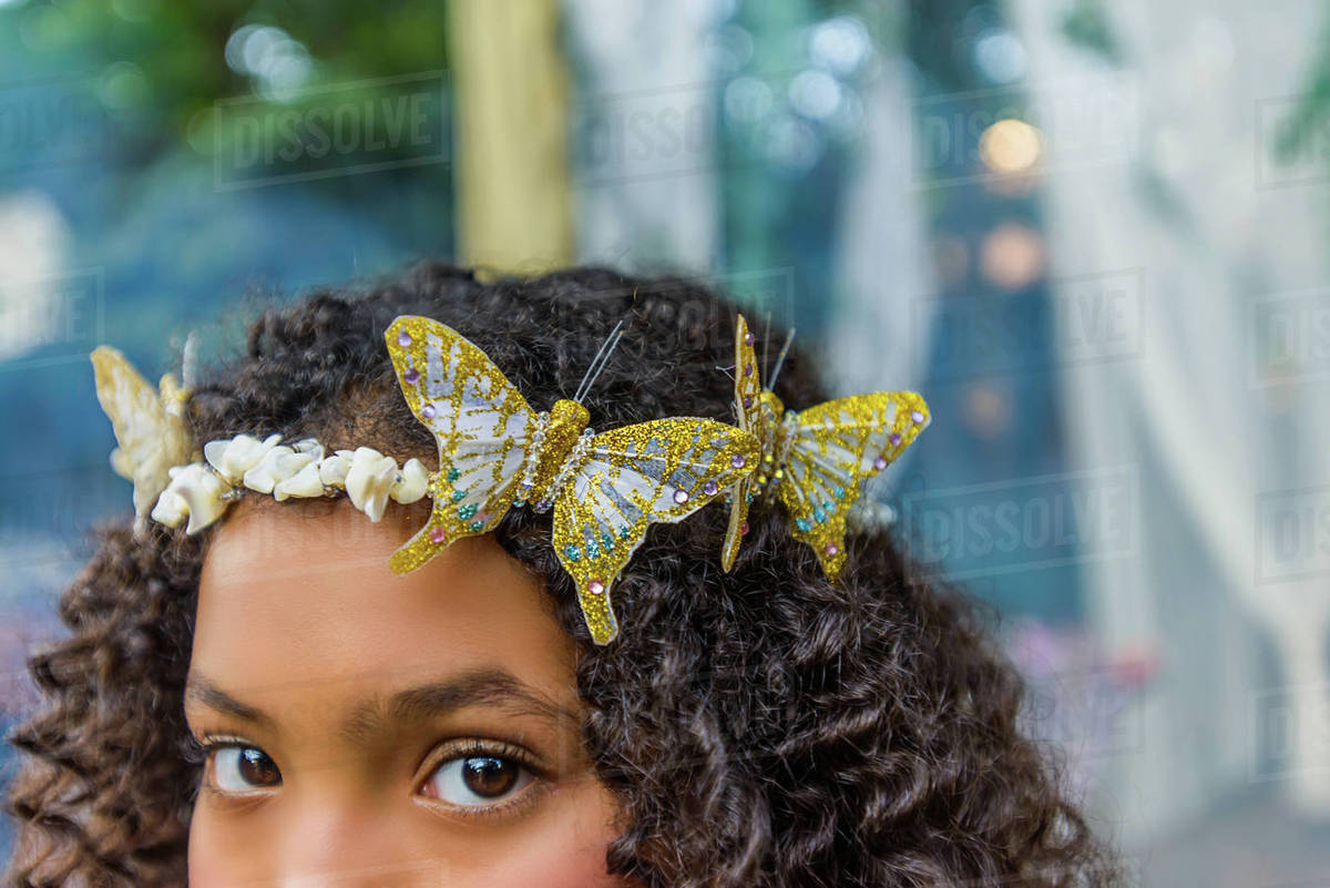Portrait of young girl wearing butterflies in hair, close-up Royalty-free stock photo