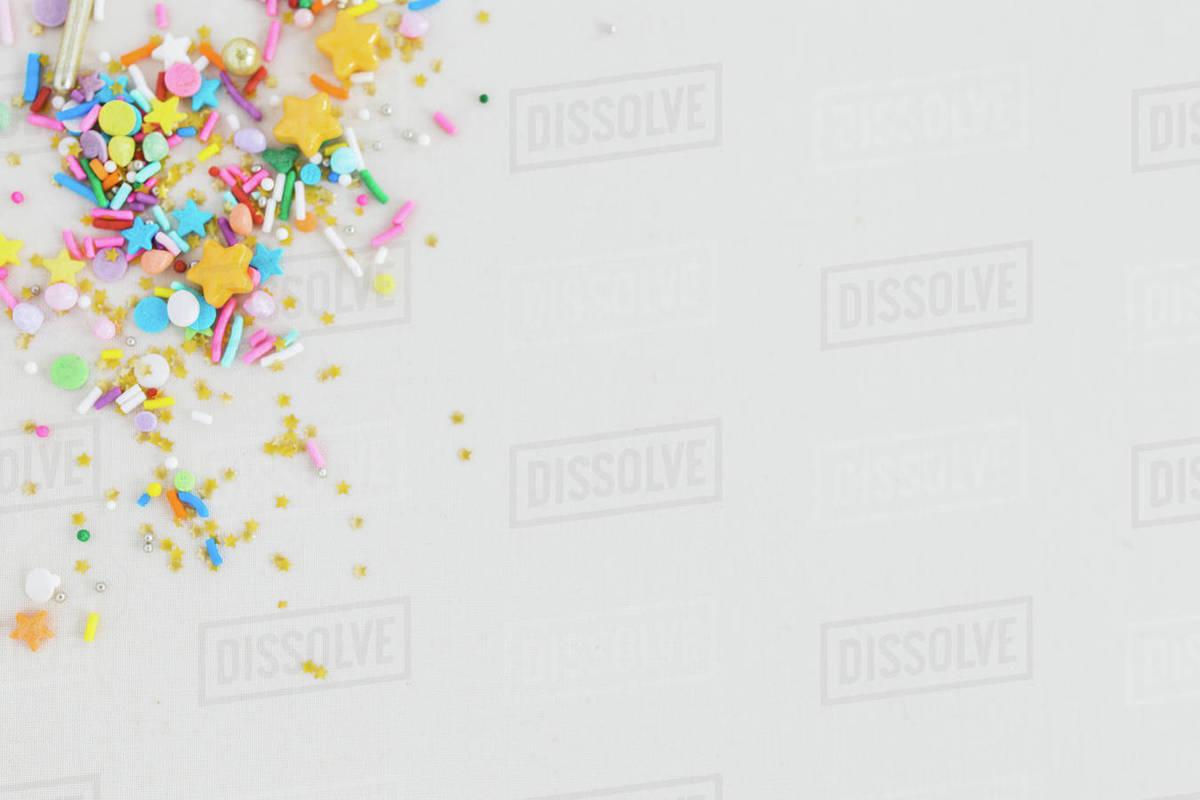 Multi-coloured multi-shaped confetti sprinkles stock photo