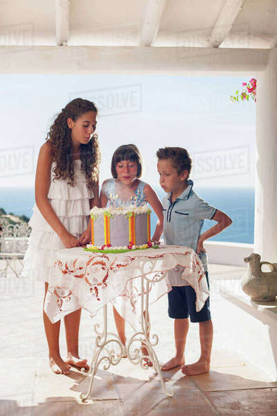 Children blowing out birthday candles Royalty-free stock photo