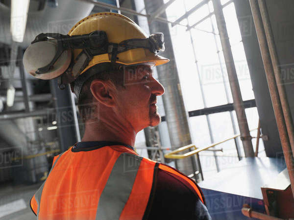 Worker wearing hard hat and headphones Royalty-free stock photo