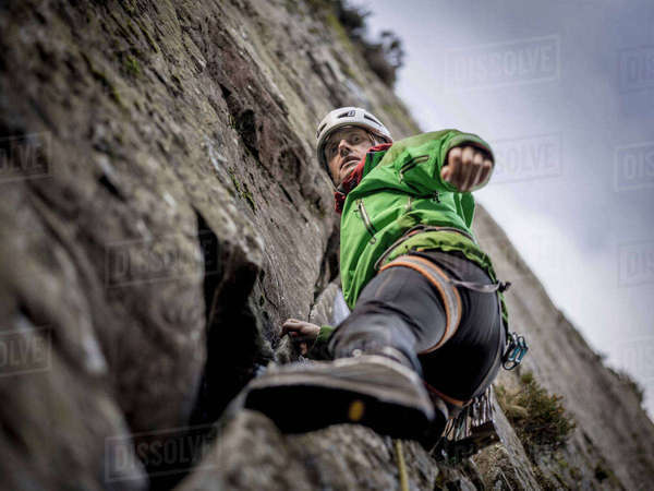Rock climber scaling steep rock face Royalty-free stock photo