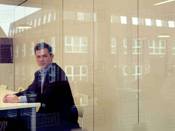 Businessman sitting at conference desk Royalty-free stock photo