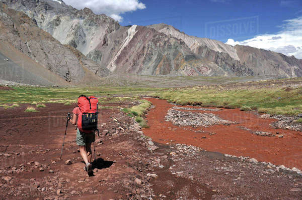 Woman descends the Horcones Valley from Plaza de Mulas on Aconcagua in the Andes Mountains, Mendoza Province, Argentina Royalty-free stock photo
