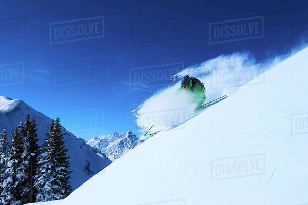 Man skiing down steep snow covered mountainside, Aspen, Colorado, USA Royalty-free stock photo