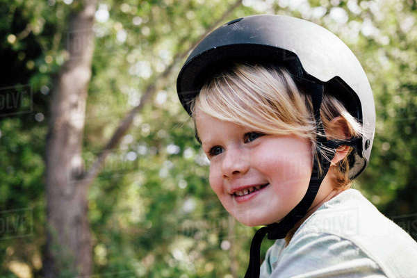 Portrait of young boy, outdoors, wearing safety helmet Royalty-free stock photo