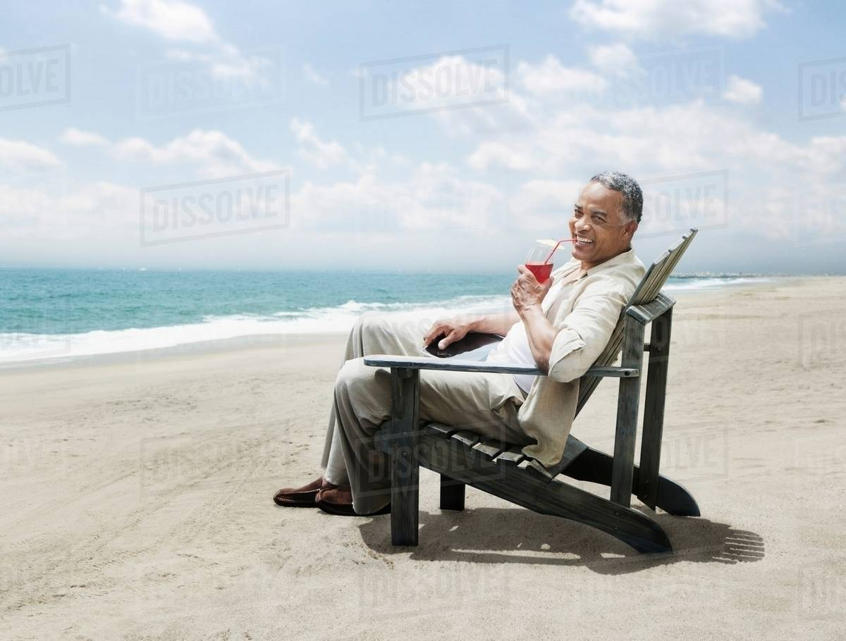 Man Relaxing In Chair On Beach