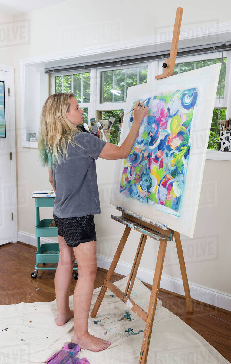 Female Artist Painting Abstract Canvas In Studio D25 145 468