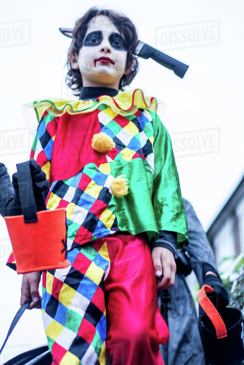 young boys dressed in halloween costume, outdoors, low angle view
