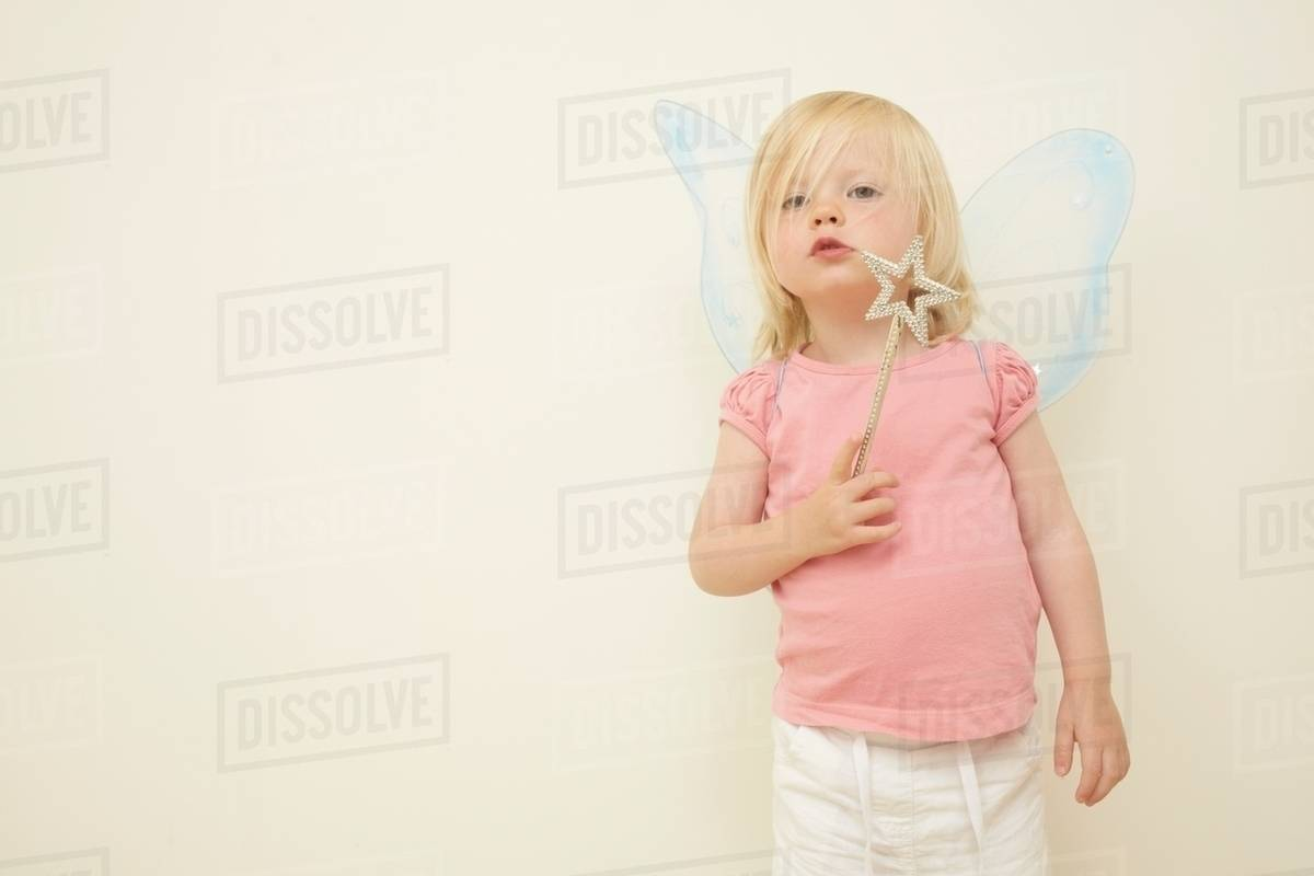 Toddler wearing wings, holding wand Royalty-free stock photo