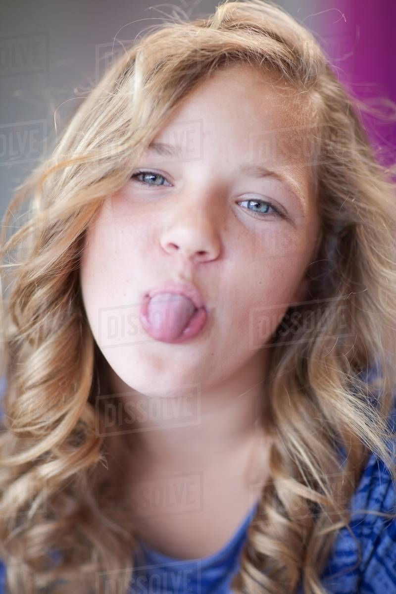Girl sticking her tongue out