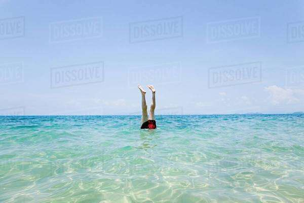 Swimmer with legs sticking out of water off Penhentian Kecil, Perhentian Islands, Malaysia Royalty-free stock photo
