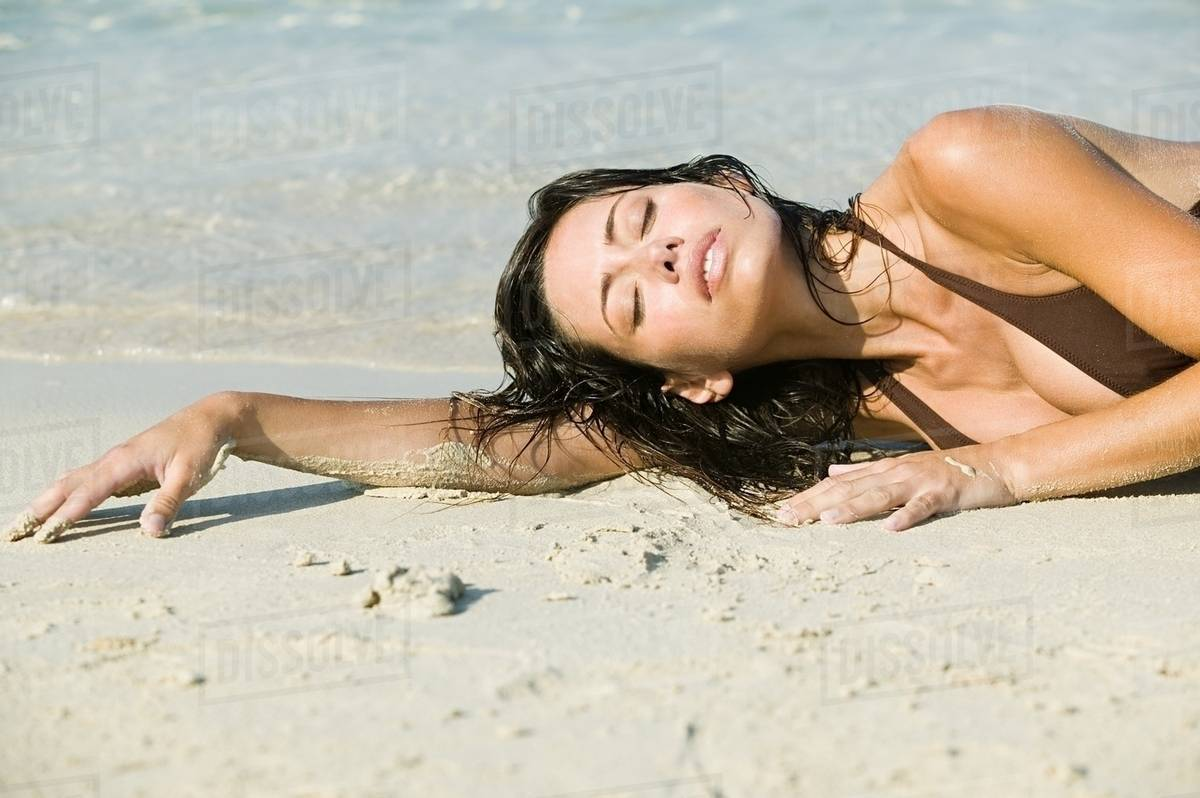 Young sexy woman lying on beach