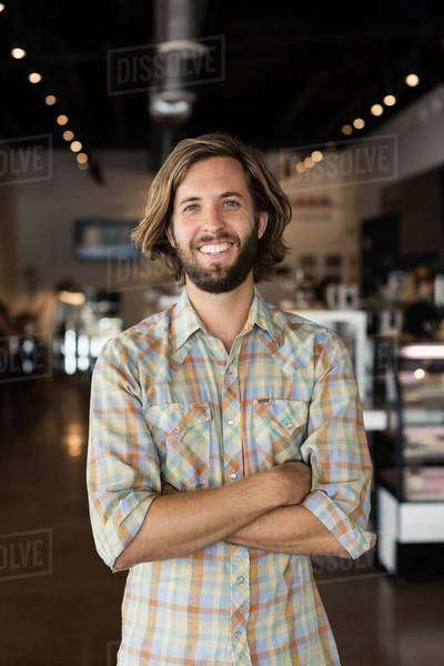Portrait of mid adult man in coffee shop Royalty-free stock photo