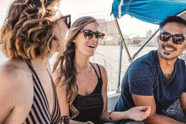Friends chatting on sailboat, San Diego Bay, California, USA Royalty-free stock photo
