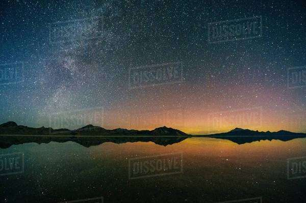 Reflecting pool of mountain range and Milky Way in dramatic night sky, Bonneville, Utah, USA Royalty-free stock photo
