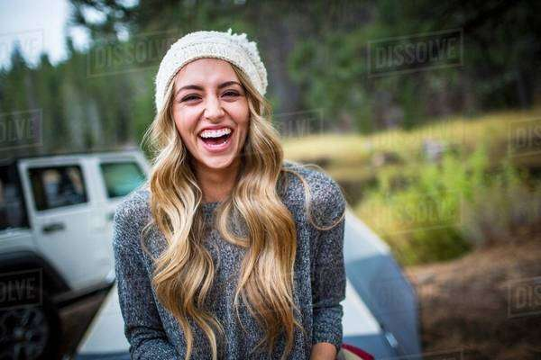 Portrait of young woman wearing knit hat at campsite, Lake Tahoe, Nevada, USA Royalty-free stock photo