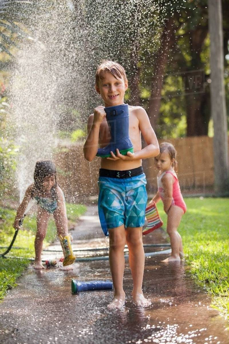 Boy Carrying Welly On Sidewalk, Girls Playing With Water -4722