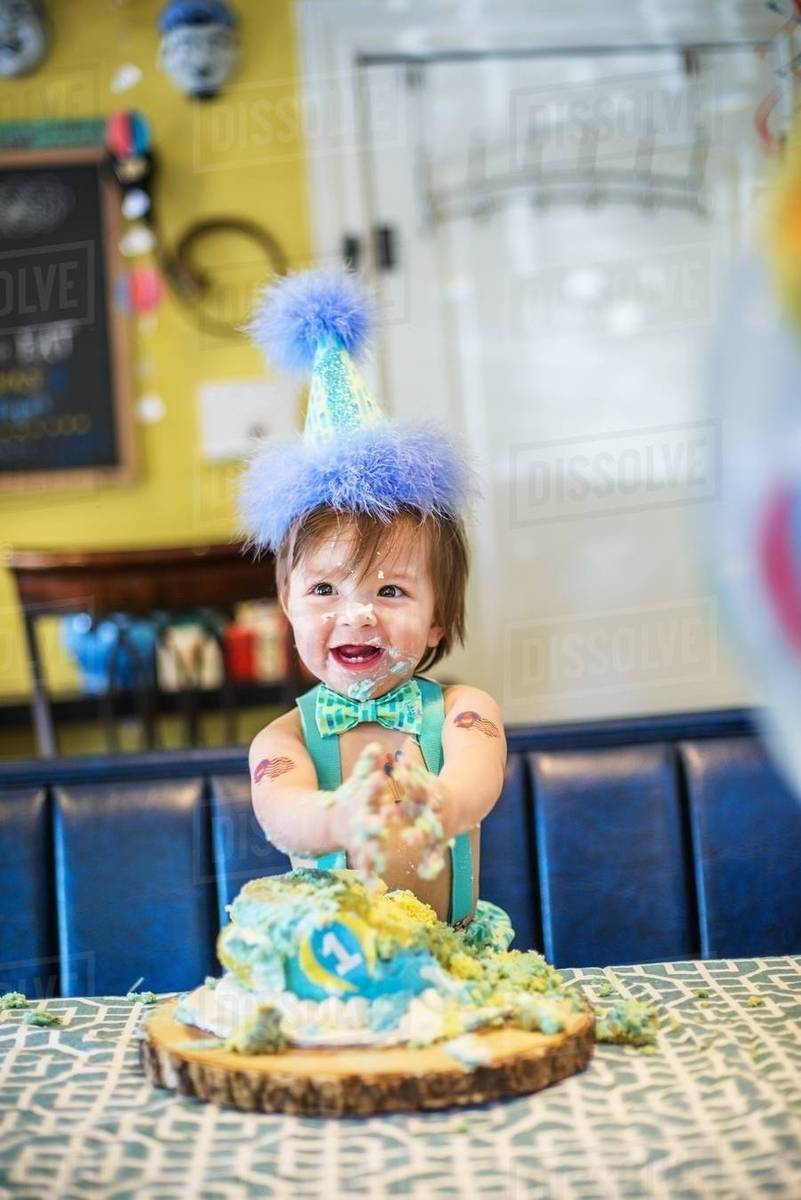 Enjoyable Baby Boy Wearing Party Hat Smashing First Birthday Cake At Table Funny Birthday Cards Online Inifofree Goldxyz