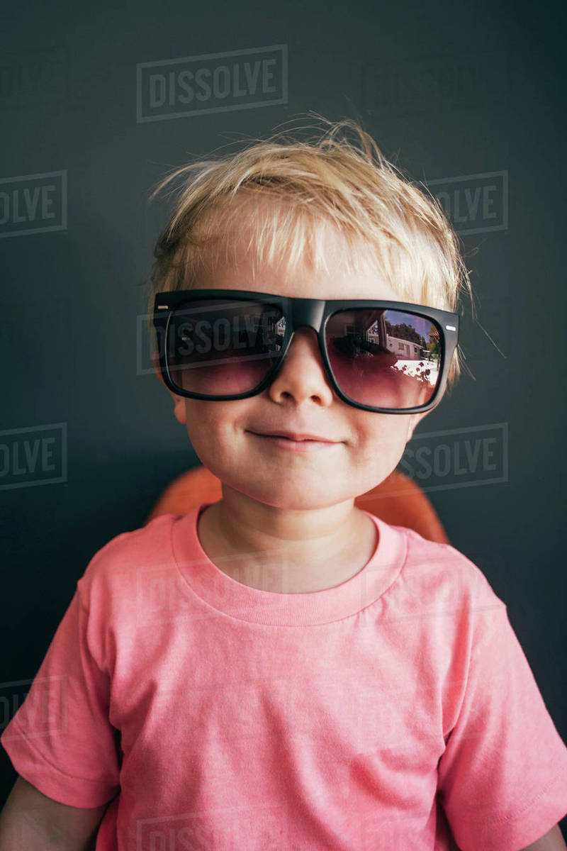 Studio portrait of cute boy wearing oversized sunglasses - Stock ... 12309bd0e