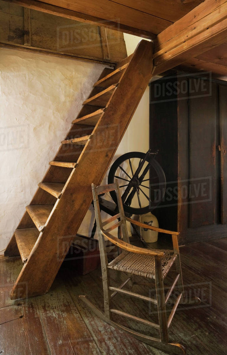 Picture of: Old Wooden Rocking Chair And Spinning Wheel Next To Stairs In The Master Bedroom Leading To Attic In 1785 Fieldstone Cottage Style Home Quebec Canada Stock Photo Dissolve