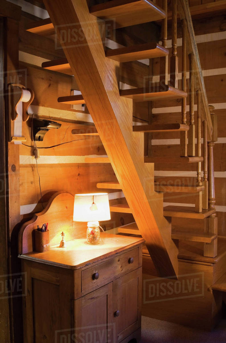 Antique Wooden Cabinet Below Uneven Wooden Stairs In Canadiana  Cottage Style Log Home, Quebec, Canada