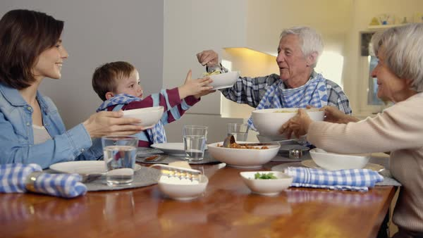 MS Multi generation family with child (4-5) eating spaghetti / Munich, Bavaria, Germany Royalty-free stock video