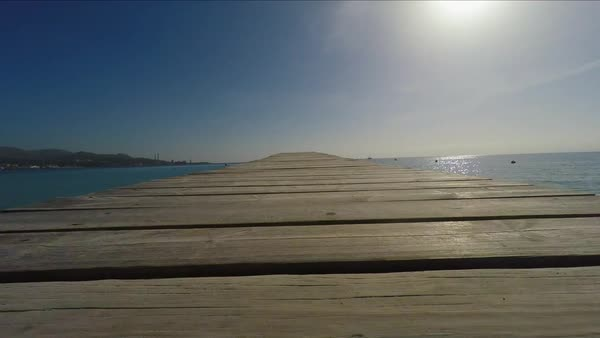 Wide angle point-of-view shot of Wooden pier in sea Royalty-free stock video