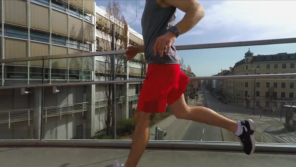 Medium shot, slow motion of man running on bridge Royalty-free stock video
