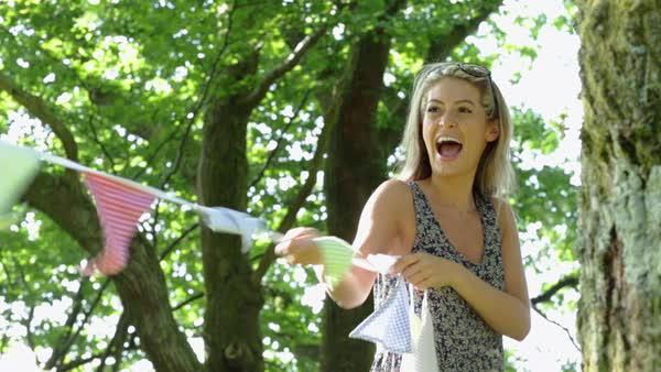 Medium shot of young woman holding bunting Royalty-free stock video