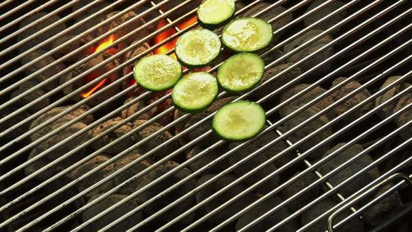 Putting courgette slices on a barbecue Royalty-free stock video