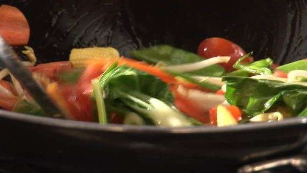 Stir-frying vegetables in a wok Royalty-free stock video