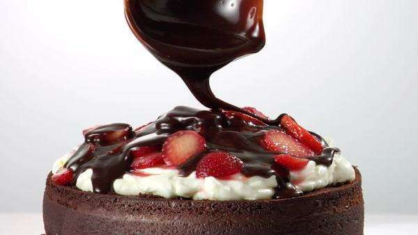 Chocolate cake with cream, strawberries and chocolate sauce Royalty-free stock video