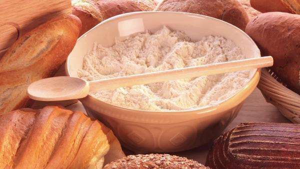 A bowl of flour, various types of bread and bread rolls Royalty-free stock video