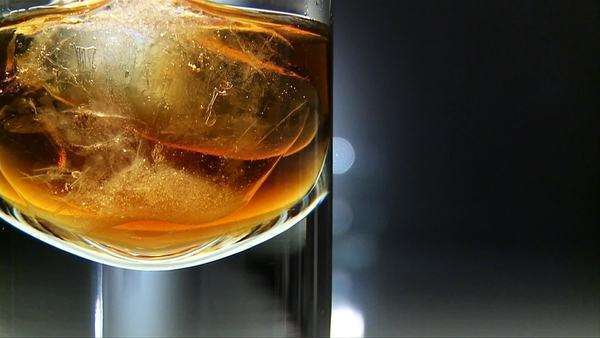 Whiskey with ice cubes Rights-managed stock video
