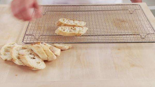 Ciabatta slices being placed on an oven rack Rights-managed stock video