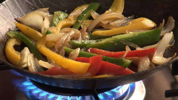 Sauteing vegetables in a frying pan Royalty-free stock video