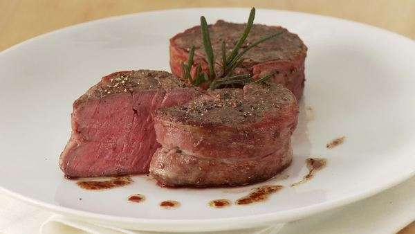 Beef fillet (fillet mignon) wrapped in bacon Royalty-free stock video