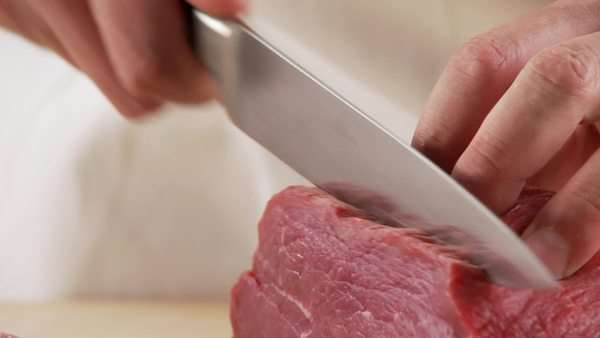Veal shoulder being being cut into escalopes Royalty-free stock video