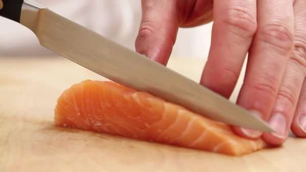 Salmon fillet being sliced Royalty-free stock video